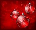 Baubles on red background Royalty Free Stock Images
