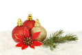 Baubles on snow red and gold christmas with a red silk flower and pine needles a bed of Stock Photo