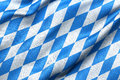 Bavaria flag highly detailed of waving in the wind light blue sky is shining through the fabric texture Royalty Free Stock Image