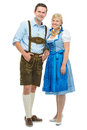Bavarian couple in dirndl beautiful traditional tracht isolated on white Royalty Free Stock Photo