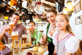 Bavarian family in german restaurant eating having traditional meal Royalty Free Stock Image