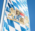 Bavarian flag the in front of blue sky Stock Photos