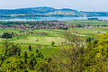 Bavarian landscape agricultural with a village lake and mountains in germany Stock Image