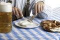 Bavarian man having lunch at Oktoberfest Royalty Free Stock Photo
