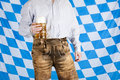 Bavarian man with leather pants holds beer stein Royalty Free Stock Photography