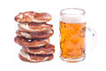 Bavarian pretzels with beer over white background Royalty Free Stock Photos
