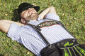 Bavarian tradition an image of a traditional man relaxing in the grass Royalty Free Stock Photo