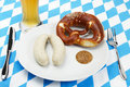 Bavarian veal sausage setup with beer from top Stock Photos