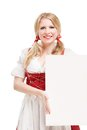 Bavarian woman in dirndl holding blank signboard isolated on white background Royalty Free Stock Photography