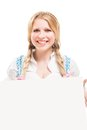 Bavarian woman in dirndl holding blank signboard isolated on white background Stock Photography