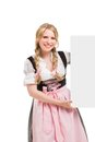 Bavarian woman in dirndl holding blank signboard isolated on white background Stock Image