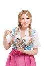 Bavarian woman in dirndl holding lebkuchen isolated on white background Stock Photos