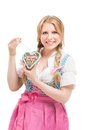 Bavarian woman in dirndl holding lebkuchen isolated on white background Royalty Free Stock Photos