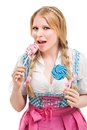 Bavarian woman in dirndl holding lollipop isolated on white background Royalty Free Stock Photos