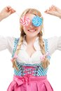 Bavarian woman in dirndl holding lollipop isolated on white background Royalty Free Stock Images