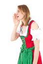 Bavarian woman in dirndl is yodelling red Stock Photography