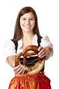Bavarian woman holding Oktoberfest Pretzel Royalty Free Stock Image