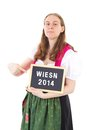 Bavarian woman shows blackboard wiesn young Royalty Free Stock Photography