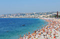 Bay of angels nice france july crowds tourists relaxing on the beach french riviera at the mediterranean sea Royalty Free Stock Image