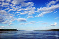 Bay with cloudy sky beautiful fjord s landscape blue Royalty Free Stock Image
