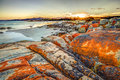 Bay of fires scenic and pristine white sandy beach with turquoise crystal waters and orange lichen covered granite boulders at Royalty Free Stock Image
