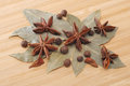 Bay leaf, allspice, and star anise on a wooden table Royalty Free Stock Photo