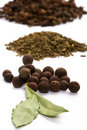 Bay leaves, cloves, caraway and black pepper Royalty Free Stock Photography
