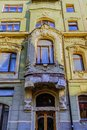 Bay window, windows, masks, stucco and architecture of a very old building in the Empire style. Moscow, Petrovsky Pereulok 8. Royalty Free Stock Photo