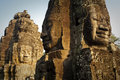 Bayon temple faces giant smiling carved into the stonework at the in the angkor thom complex cambodia Stock Image