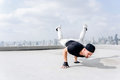 Bboy doing some stunts. Street artist breakdancing outdoors Royalty Free Stock Photo