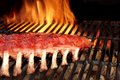 BBQ Baby Back Pork Ribs On The Hot Flaming Grill Royalty Free Stock Photo
