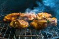 Bbq berbecue baked chicken legs meat food roast grilled on the grill Royalty Free Stock Photo