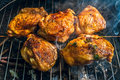 Bbq berbecue baked chicken legs meat food roast grilled on the grill Royalty Free Stock Photography