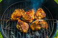 Bbq berbecue baked chicken legs meat food roast grilled on the grill Stock Photos