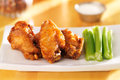 Bbq buffalo chicken wings with ranch dip and celery Stock Photo