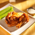 Bbq buffalo chicken wings with ranch dip and celery Royalty Free Stock Photography