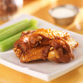Bbq buffalo chicken wings with ranch dip and celery Royalty Free Stock Image