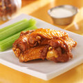 Bbq buffalo wings with celery and ranch dip Stock Photo