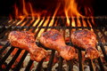 BBQ Chicken Legs Roasted On Hot Charcoal Grill Royalty Free Stock Photo