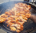 Bbq chicken wings cooking on a hot grill Stock Photography