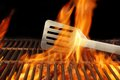 Bbq fire flame hot grill spatula xxxl with space for text or image Royalty Free Stock Images