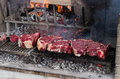 Bbq with florentines steaks thick slices of meat from chianina cow grilling over the embers Stock Photography