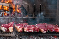 Bbq with florentines steaks thick slices of meat from chianina cow grilling over the embers Royalty Free Stock Image