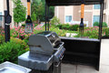 Bbq grill outdoor with gas tools and tables for business gathering party Royalty Free Stock Images