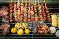 BBQ grill with pork and vegetable on fire. Royalty Free Stock Photo