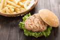 Bbq hamburger with french fries on the wooden background. Royalty Free Stock Photo