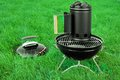 BBQ Kettle Grill With Charcoal Briquettes Starter On The Lawn Royalty Free Stock Photo