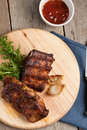 Bbq ribs barbecue pork on a wooden board Royalty Free Stock Photo