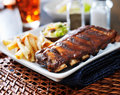 Bbq ribs with cole slaw and french fries Royalty Free Stock Images