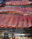 Bbq ribs racks of on a hot grill Stock Image